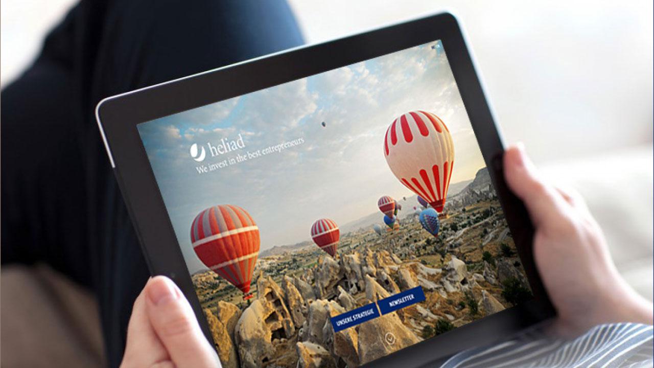 Heliad Markenbild Tablet HeliadEquity-Partners multimedial appearance